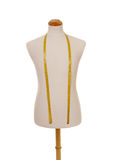 Mannequin torso with tape measure. Front view of male torso mannequin with yellow tape measure Royalty Free Stock Photos