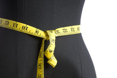 Mannequin Torso with Yellow Measuring Tape Royalty Free Stock Photos