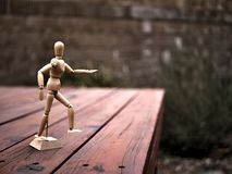 Artist`s Articulating Wood Drawing Mannequin on Wooden Deck royalty free stock photography