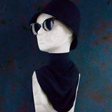 Mannequin Wearing Black Hat Sunglasses and Scarf Stock Photo
