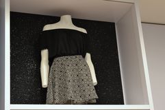 Mannequin wearing black shirt with black and white skirt. Stock Image