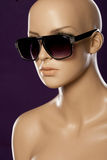 Mannequin wearing fashion sunglasses Royalty Free Stock Images