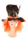 Mannequin wearing Mad hatter tea party hat and wig Royalty Free Stock Images