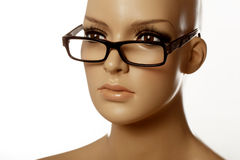 Mannequin wearing spec reading glasses on white Stock Photo