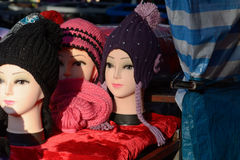 Mannequin wearing winter hats at market stall Royalty Free Stock Images