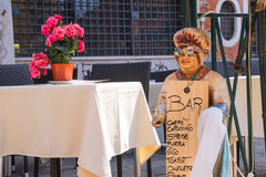 Mannequin welcoming cook in an outdoor cafe,Venice, Italy Stock Photo