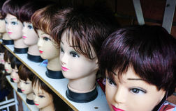 Mannequin wigs at salon studio Stock Photos