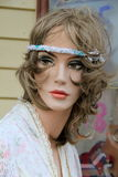 Mannequin of woman with made up eyes and headband Stock Photos