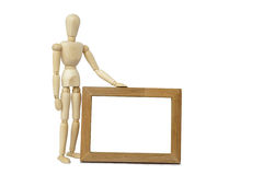 Mannequin  and wooden frame Royalty Free Stock Photo