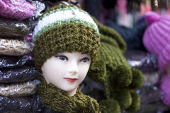 Mannequin with woolly hat and scarf. Mannequin head wearing a woolly hat and scarf Royalty Free Stock Photo