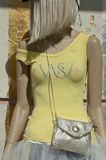 Mannequin in a yellow shirt. Mannequin in yellow t-shirt with silver handbag sunlit Stock Photography