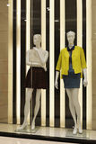 Mannequins in clothing shop window Royalty Free Stock Photos