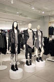 Mannequins in a clothing store dressed in edgy, punk style. Three mannequins dressed in edgy, rock and punk fashion style clothes Stock Photography