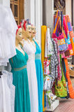 Mannequins in dress in shopfront. Smile female mannequins in dresses near shop Stock Images