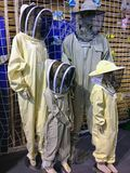Mannequins dressed as a family of bee keepers royalty free stock images