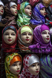 Mannequins dressed in colourful headscarves in the Fez medina in Morocco. Stock Images