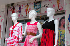Mannequins dressed with latest fashion in front of clothes retail shop Royalty Free Stock Photo