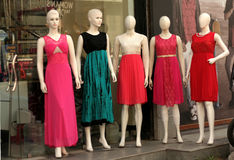 Mannequins in fashion clothing shop Stock Images