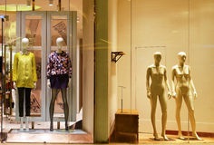 Mannequins in fashion shop window. Mannequins in clothing store window,Hongkong central,China,Asia Royalty Free Stock Photo