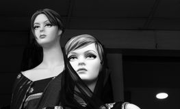 Mannequins in front of a clothes retail shop Stock Photography