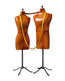 Mannequins. Illustration of a pair of respectively male-shaped and female-shaped tailoring mannequins bound by a long measuring tape around their necks Stock Images