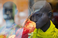 Mannequins. Male mannequin smelling a textile flower in a clothing store Stock Photography