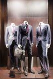 Mannequins in a men fashion store Stock Photos