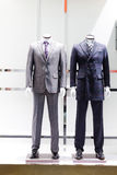 Mannequins in a men fashion store Stock Photo