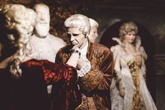 Mannequins of people in historical dresses, wigs and jewels at the ball, courtiers, an exhibition. Mannequins of people in historical dresses, wigs and jewels at royalty free stock photos