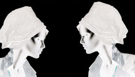 Mannequins, plastic dolls. Set of female head dummies isolated on a black background Stock Images