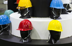 Mannequins with Safety helmets on a shelf ; Working Hard Hat. Personal Protection Equipment PPE Stock Photos