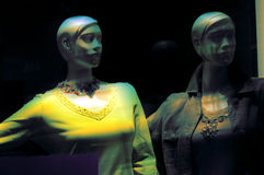 Mannequins in shop window. At night Stock Image