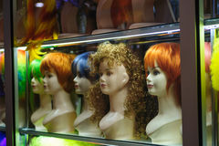 Mannequins in a shop window with colored hair Stock Photography