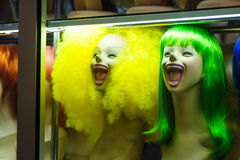 Mannequins in a shop window with colored hair Stock Photo