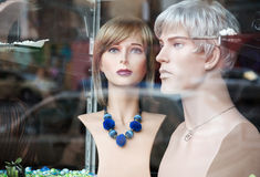 Mannequins in shop window Stock Images