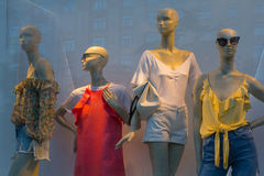 Mannequins in a shop window Stock Photos