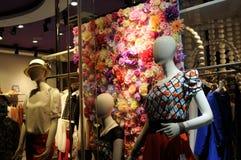 Mannequins in shopwindow Stock Photos