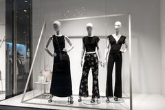 Mannequins stand in the store. Mannequins show clothes in the store Royalty Free Stock Image