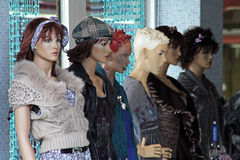 Mannequins on a fashion shop window royalty free stock images