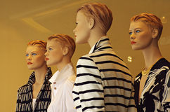 Mannequins in showcase of a shop Stock Photo