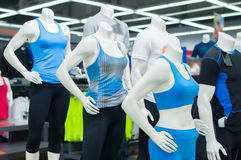cb8b7d772749 Mannequins in sport athletics suits in mall. Mannequins in sport athletics  suits in shop royalty