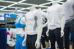Mannequins in sport athletics suits in mall Stock Images
