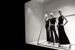 Mannequins stand in the store. Mannequins show clothes in the store Royalty Free Stock Images