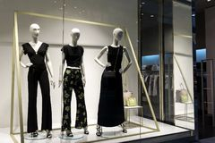 Mannequins stand in the store. Mannequins show clothes in the store Royalty Free Stock Photo