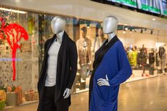 Mannequins standing in the shop window Display casual woman and man clothing store in the Mall. Or shopping center Royalty Free Stock Images