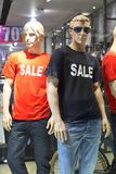 Mannequins standing in store window display. In casual clothing shop in shopping mall Royalty Free Stock Image