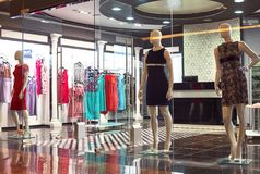 Mannequins standing in store window display. Of women s casual clothing shop in shopping mall Stock Images