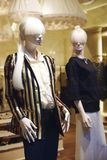 Mannequins standing in store window display royalty free stock photo