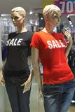 Mannequins standing in store window display of womens casual clo. Thing shop in shopping mall Stock Image
