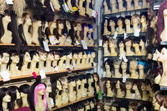 Mannequins with variegated style wigs on shelves. Of hair salon Stock Photo
